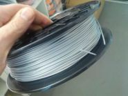 Катушка пластика FlexPolyEster 45D серебристый 1.75 мм 0,5кг., Германия
