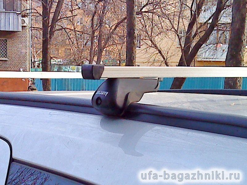 Багажник на крышу Opel Astra, прямоугольные дуги на интегрированные рейлинги, Атлант