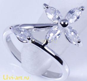 Элегантное позолоченное белым золотом кольцо с топазами