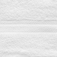 Махровое однотонное полотенце белого цвета.