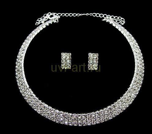 Комплект элегантных позолоченных белым золотом украшений для невесты - колье и серьги с кристаллами Сваровски