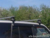 Багажник на крышу Hyundai Tucson без рейлингов, Атлант, аэродинамические дуги