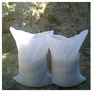 Песок строительный в мешках