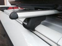 Багажник на крышу Kia Soul 2014-... с интегрированными рейлингами, Атлант, аэродинамические дуги