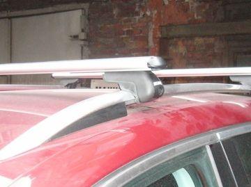 Багажник на крышу Volkswagen Tiguan 2007-16, Атлант, аэродинамические дуги на рейлинги