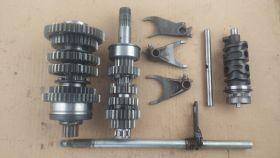комплект. валы коробки передач: первичный, вторичный; вилки коробки передач (3шт.); копирный вал; вал переключения передач  Honda  CB1