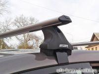 Багажник на крышу Lada Vesta, Атлант, аэродинамические дуги, опора E