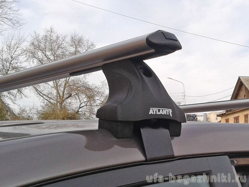 Багажник на крышу на Mitsubishi L200 2015-..., Атлант, аэродинамические дуги, опора Е