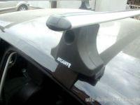 Багажник на крышу Kia Cerato LD 2004-09, Атлант, аэродинамические дуги