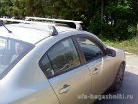 Багажник на крышу Mazda 3 (BL) 2009-2013, Атлант, прямоугольные дуги, опора E