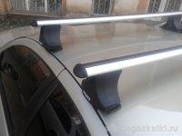 Багажник на крышу Nissan Almera Classic, Атлант, аэродинамические дуги