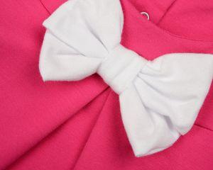 Розовое платье с белым бантом для девочки