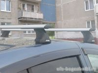 Багажник на крышу Renault Sandero, Атлант, крыловидные дуги, опора Е