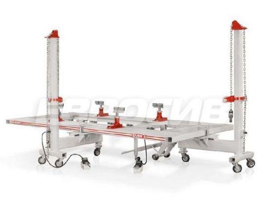 Платформенный стапель для кузовного ремонта с прямоугольной платформой из квадратных металлических труб грузоподъёмностью 3 т, с двумя подкатными силовыми устройствами башенного типа с max усилием 10 т.