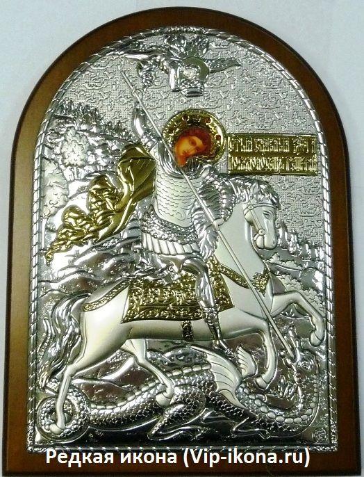 Инкрустированная гранатами серебряная с золочением икона Святого Георгия Победоносца (14.5*20см., Россия) в подарочной коробке