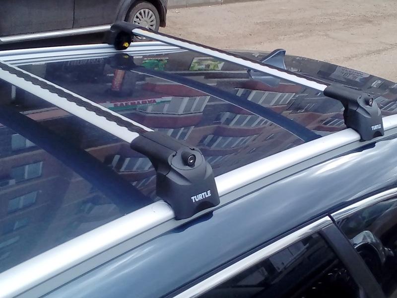 Багажник на крышу Kia Ceed sw universal 2018-..., Turtle Air 2, аэродинамические дуги на интегрированные рейлинги (серебристый цвет)