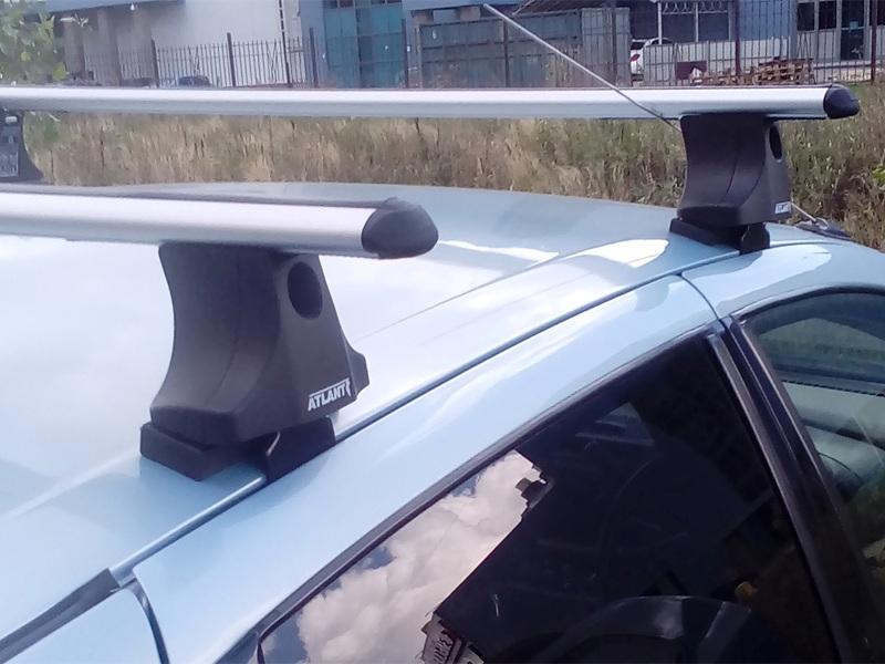 Багажник на крышу Nissan Tino (без рейлингов), Атлант, аэродинамические дуги