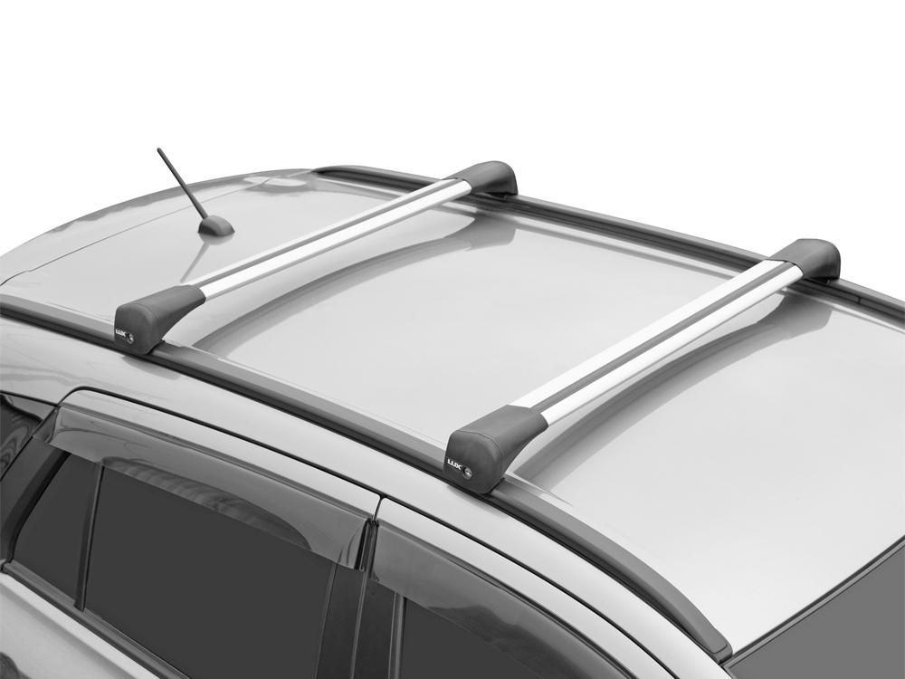 Багажник на крышу Geely Atlas 2017-..., Lux Bridge, крыловидные дуги (серебристый цвет)