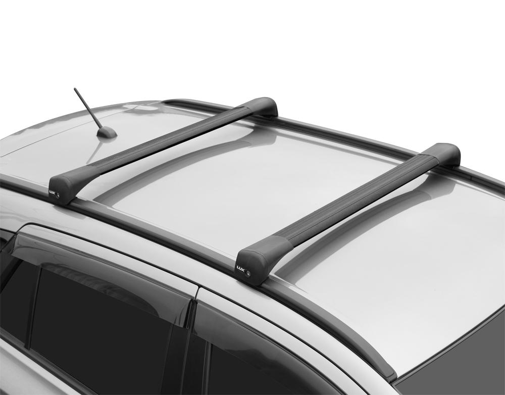 Багажник на крышу Mitsubishi Pajero Sport 2016г-..., Lux Bridge, крыловидные дуги (черный цвет)
