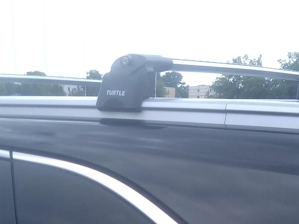 Багажник на крышу Kia Sorento Prime 2016-..., Turtle Air 2, аэродинамические дуги на интегрированные рейлинги (серебристый цвет)