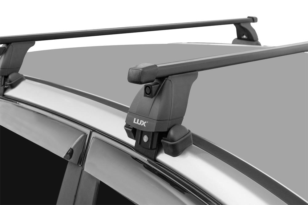 Багажник на крышу Skoda Rapid 2017-..., Lux, стальные прямоугольные дуги