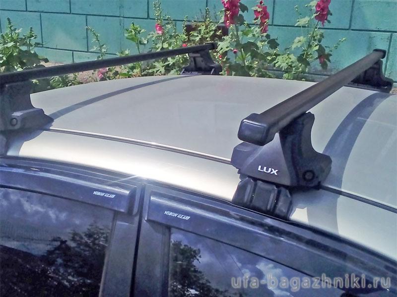 Универсальный багажник на крышу D-Lux 2, стальные прямоугольные дуги