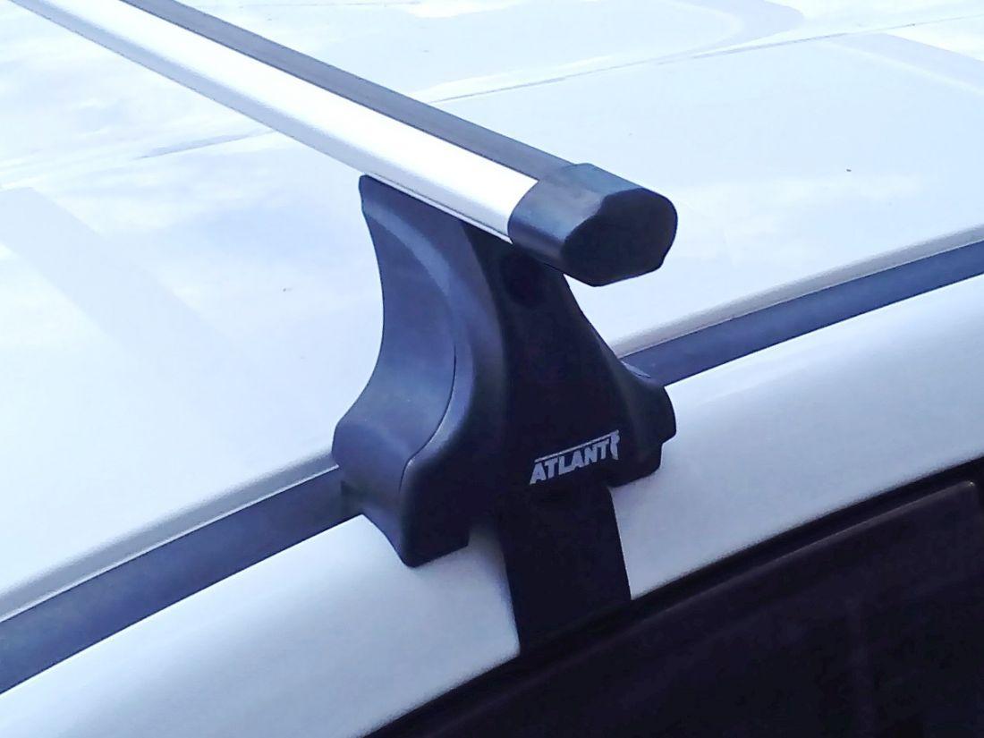 Багажник на крышу Renault Kaptur, Атлант, аэродинамические дуги Эконом, опора Е